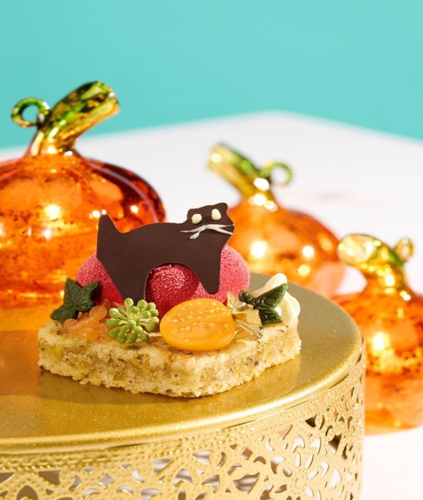 A Halloween Cat, sweet red pepper pannacotta on a pistachio sponge with orange caviar pearls.